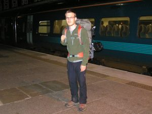 Man in hiking gear with heavy backpack