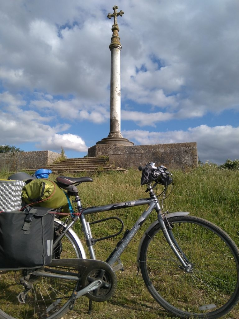 Bike with heavy baggage, memorial in background